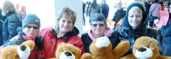 SSWCC workers posing with teddy bears